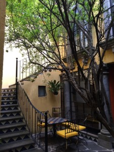 Partial view of the courtyard space. If you look carefully, you can see the pomegranates in the tree.